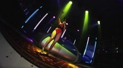 Sexy mc girl in hare mask red bodysuit energy dance on stage of nightclub - stock footage