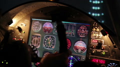 Pilot landing private airliner, view on flight panel and illuminated runway Stock Footage