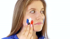 Girl painting her face with French flag Stock Footage