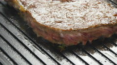 Cooking delicious juicy meat steaks on the grill Stock Footage