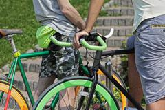Two cyclist and colorful city bikes. Sport - stock photo
