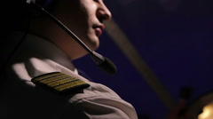 Airman dressed in uniform with epaulettes flying airplane, professional at work Stock Footage