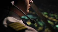 Flight over city during night time, male pilot steering airplane, aviation Stock Footage