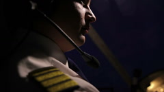 Male pilot operating plane at night, something's wrong, moment before accident Stock Footage