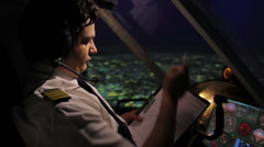 Pilot filling out flight documentation, plane flying in autopilot mode, aviation Stock Footage