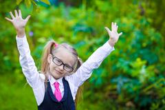 Portrait of adorable little school girl in glasses outdoor Stock Photos