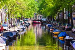 Beautiful canal in the old city of Amsterdam, Netherlands, North Holland Kuvituskuvat