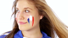 Girl with French flag on her face smiling Stock Footage