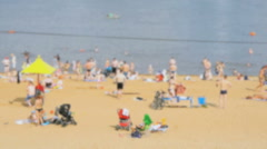 People sunbathing on the crowded sand beach Stock Footage