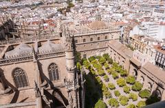 Orange tree courtyard of the Seville Cathedral - stock photo