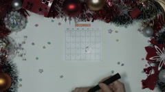 4k Christmas Composition on a White Background with December Circled on Calendar - stock footage