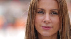 Young woman in city face portrait caucasian serious slow motion - stock footage