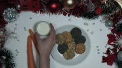 4k Christmas Composition on a White Background- Carrot, Milk, Cookies for Santa - stock footage