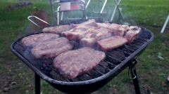 Close up of meat cooking on grill for summer bbq - stock footage
