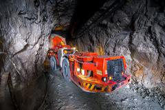 Loading truck with gold ore - stock photo