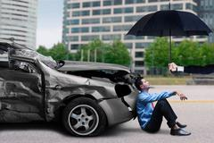 Man waiting a help after traffic accident - stock photo