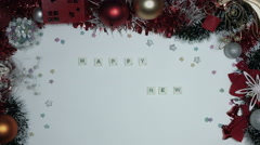 4k Christmas Composition on a White Background- Scrabble letters: Happy New Year - stock footage