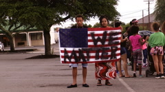Black lives protest angry man woman US flag defaced Stock Footage