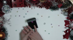 4k Christmas Composition on a White Background- Hand putting on Engagement Ring Stock Footage