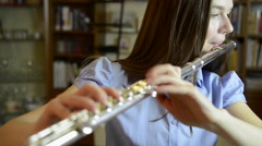 Young girl playing the flute Stock Footage