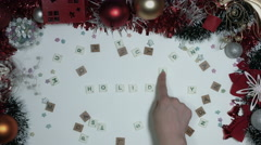 4k Christmas Composition on a White Background- Scrabble letters: Holiday - stock footage