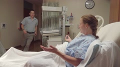 Pregnant Wife Waiting On Husband In Hospital Baby Ward - stock footage