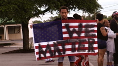 Angry young man black lives defaced American flag Stock Footage