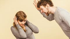 Aggressive man yelling on woman. Kuvituskuvat