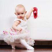 Little girl with red shoes Stock Photos