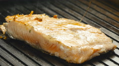 Grilled red fish steak salmon on the grill - stock footage