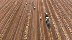 Tractor making hay from straws aerial view 4K Stock Footage
