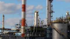 Oil refinery in sunny beautiful weather with clouds in background Stock Footage