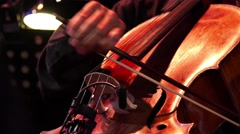Concert, a man playing the cello, hand close up - stock footage