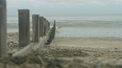 4K Wave breakers & shoreline on beach at low tide. No people. Stock Footage