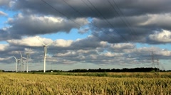 Wind power station turbines in sunny weather with clouds on wind Stock Footage