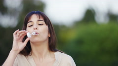 4K Attractive woman blowing bubbles, in slow motion, with space for text - stock footage