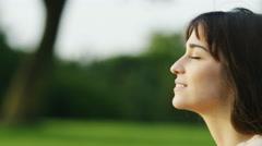 4K Profile portrait of a woman looking ahead, in slow motion Stock Footage