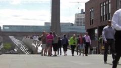 People walk on London Millennium Footbridge Stock Footage