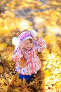 Daughter girl female child sit  love family autumn yellow leaves trees nature Stock Photos