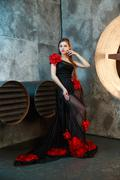 Young girl in black vintage dress posing near ventilation pipes. proudly and Stock Photos