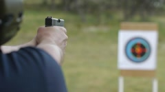 Man Firing Gun at Target Stock Footage