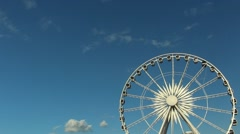 Big ferris wheel on blue sky background Stock Footage