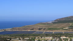Time lapse zoom pan of lagoon and grow fields in Ventura, California Stock Footage