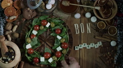 4k Christmas Composition on a Wooden Background with a Nice Food Crown - stock footage
