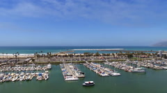 Aerial drone footage above California harbor to Pacific Ocean Stock Footage
