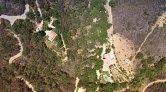 Aerial drone above estates and valleys in Malibu hills Stock Footage