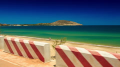 Camera Moves along Road Side Barrier by Sea Beach Stock Footage