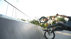 BMX rider does various tricks while riding in skatepark Stock Footage