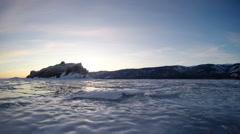 Sunset on the frozen Lake Baikal, Elenka island. Irkutsk region, Russia. Full HD Stock Footage