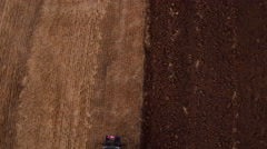 Aerial view of Farming tractor plowing on wheat field Stock Footage